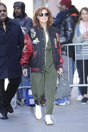 Underneath her coat, Susan Sarandon wore an edgy army-green zip-up jumpsuit.