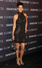 Halle added a little downtown chic to her sexy LBD dress, with a chain strap leather shoulder bag.