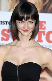 Alexandra sported a sleek bob with blunt-cut bangs.