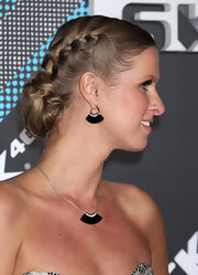 Nicky Hilton pulled her tresses up in a double sided braided bun for the T-Mobile launch event.