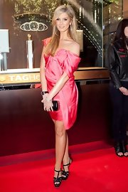 Delta Goodrem attended the Tag Heuer boutique opening wearing black YSL Tribute sandals with a hot-pink dress.