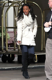 Tanya Chisholm stepped out in Canada bundled up in a white puffer coat and over-the-knee suede boots.