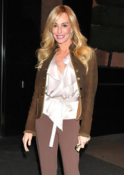 Taylor Armstrong kept her look ladylike with a silky ivory ruffle blouse.