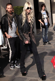 Taylor Momsen towered in massive black platform pumps while making her way through Paris.