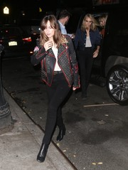 Dakota Johnson got majorly edgy in a studded leather jacket by Gucci for a night out with Taylor Swift.