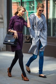 Karlie Kloss covered up in a stylish gray trenchcoat while out and about with bestie Taylor Swift.