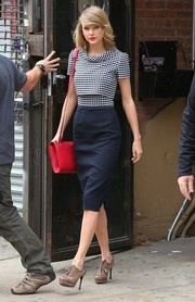 Taylor Swift left her gym looking oh-so-stylish in an checkered-bodice dress by Oscar de la Renta.