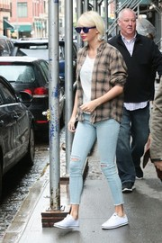Taylor Swift was grunge-chic in a tan flannel shirt layered over a white tee while out and about in New York City.