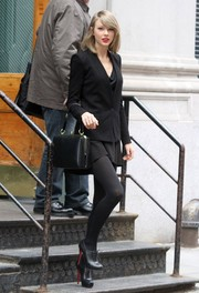 Taylor Swift teamed black Christian Louboutin brogues with a blazer and an LBD for some low-key sophistication in New York City.
