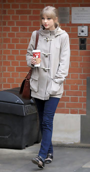 Taylor Swift ditched her favorite dresses for a cozy toggle coat and skinny jeans.