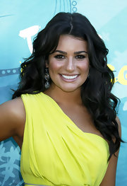 Lea complemented her bright lime dress with some chunky, sparkling statement earrings.