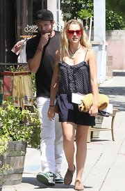 Teresa Palmer chose this polka dot blouse with spaghetti straps for her look while out with Mark Webber.