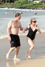 Kathy Hilton took a dip wearing a black one-piece swimsuit.