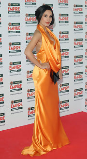 Preeya was bold in an orange silk evening gown with a deep cowl neckline at the Empire Film Awards.