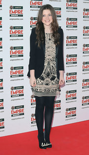 Georgie looked like a doll in a beaded frock and blazer at the Empire Film Awards in London.