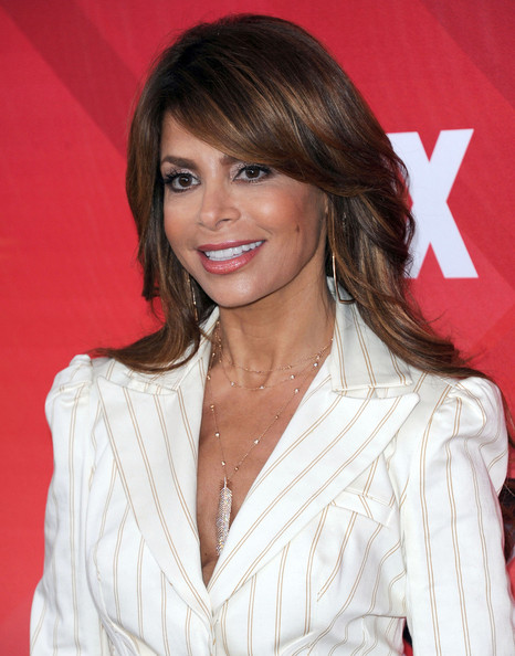 At a press conference for The X Factor, Paula Abdul wore her long layered cut with a sexy side part and soft waves.