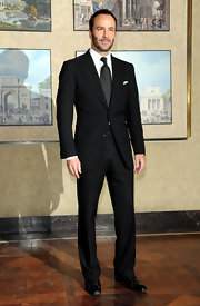 Tom Ford kept things basic with a black suit and black dress shoes.