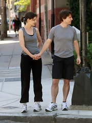 Tom goes for a run with his wife, wearing Asics running shoes, in white.