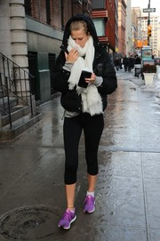 Toni Garrn gave her look a pop of color with a pair of purple Adidas sneakers.