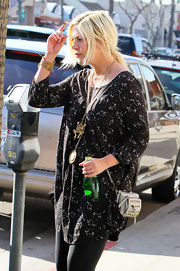 Tori Spelling covered up in a relaxed black-and-white print blouse.