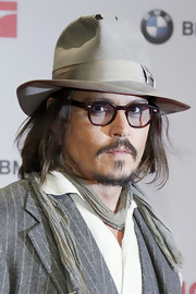 Johnny Depp paired his eccentric look with a taupe fedora hat.