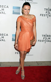Malin Akerman added contrast to her peach leather dress with gray ankle strap sandals with cream platforms.