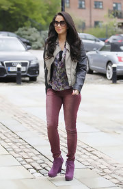 Tulisa Contostavlos headed out in Manchester wearing a bright purple pair of wedge ankle boots.
