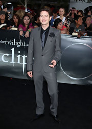 Jackson showed off his stylish side in a grey suit complete with a silver tie and black dress shoes.