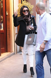 Vanessa Hudgens trekked through town in slouchy white skinny jeans and a pair of black suede booties.