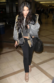 Vanessa Hudgens headed to the airport in a pair of tan clogs.