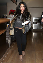 Vanessa Hudgens made her way through LAX in black low-waisted harem pants with zippered pockets.