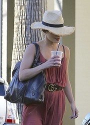 Vanessa Hudgens went on a smoothie run wearing a loose jumpsuit, which she cinched in with a Gucci leather belt.