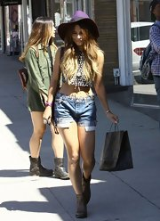 Vanessa dressed up her every day shopping look with a polka dot crop top and denim shorty shorts.
