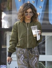 Vanessa Hudgens was spotted out in LA looking trendy in a green bomber jacket.