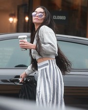 Vanessa Hudgens looked funky in her mirrored lavender shades while grabbing coffee.