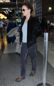 Vanessa Paradis caught a flight out of LAX looking tough in a black velvet bomber jacket.