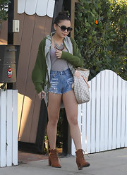Stella Hudgens paired her cut-off shorts with tan lace-up boots.
