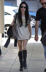 Lisa Origliasso showed her fascination with boots as she wore another pair of knee-high lace ups.