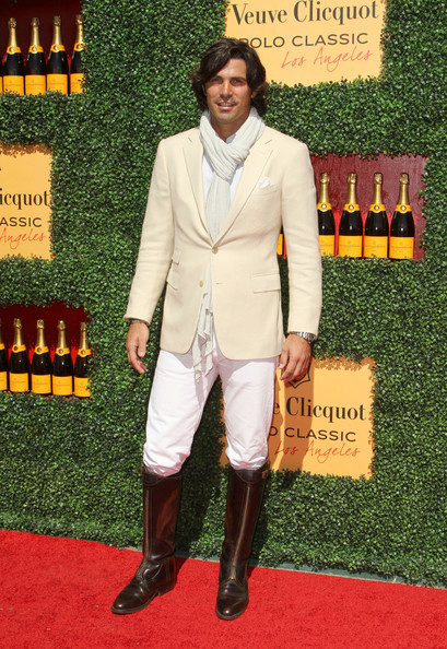 Nacho Figueras looked oh-so-classy in his beige blazer, white pants, riding boots, and scarf at the Veuve Clicquot Polo Classic.