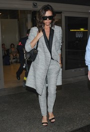 Victoria Beckham teamed her suit with Manolo Blahnik Chaos sandals, in black.