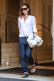 Victoria Beckham completed her relaxed ensemble with flat sandals by Celine.