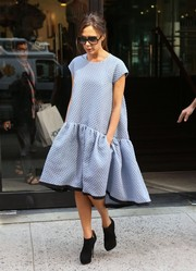 Victoria Beckham added some edginess to her feminine look with a pair of black ankle boots.