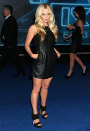 Charlotte Ross paired a sexy leather mini dress with suede platform sandals. The heels feature interesting ankle cuffs.