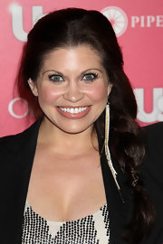 Danielle Fishel accessorized with a single dangling chain earring at the Us Weekly Hot Hollywood Party.