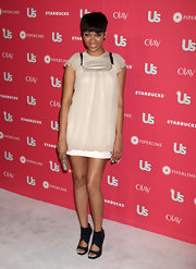 Bria Murphy complemented her girly dress with edgy yet chic cutout boots.