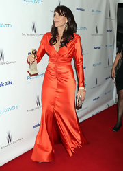 Katey Sagal was glowing at the 2011 Golden Globes in a ruched orange evening dress.