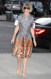 Anna Wintour donned a crisp taffeta print cocktail dress for the premiere of 'The Whistleblower.' Anna layered a beaded necklace and donned her signature bob for the look.
