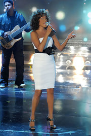 Whitney Houston guested on Italy's 'X Factor' wearing a white strapless dress with a contrasting flower waistband.