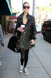 Whitney Port stayed on trend in a pair of Ray-Ban wayfarers, the perfect eye wear when confronted with hoards of paparazzi!