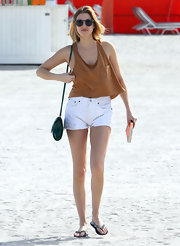 Whitney paired her casual beach ensemble with embellished sandals.